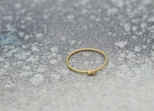 Kira Helmer - Diamond and ball ring, gold